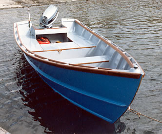 Bow view of wood boat layed out for fishing